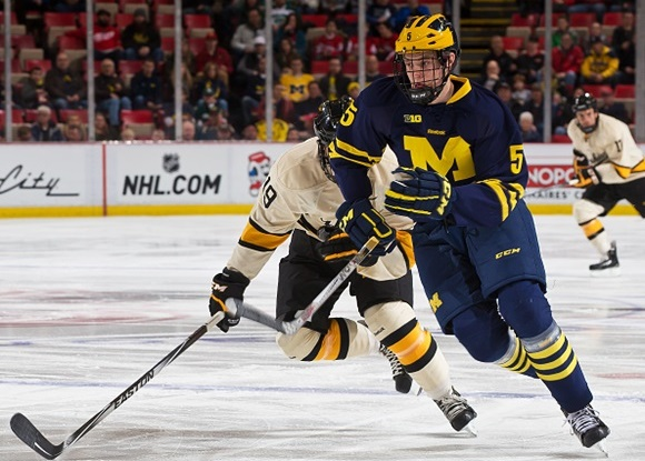 Photo: Michael Downing had 22 points (six goals, 16 assists) in 36 games in his sophomore season with the University of Michigan . (Photo by Dave Reginek/Getty Images)