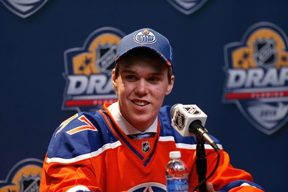 Photo: Connor McDavid answers questions after being taken 1st overall in the 2015 NHL Draft by the Edmonton Oilers. (Courtesy of Eliot J. Schechter/NHLI via Getty Images)