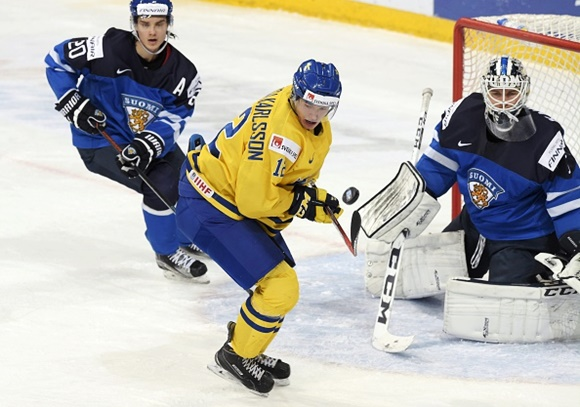 Sebastian Aho (L) and Kaapo Kahkonen (R) - Team Finland; Jakob Forsbacka-Karlsson - Team Sweden (C) - 2016 IIHF World Junior Championship